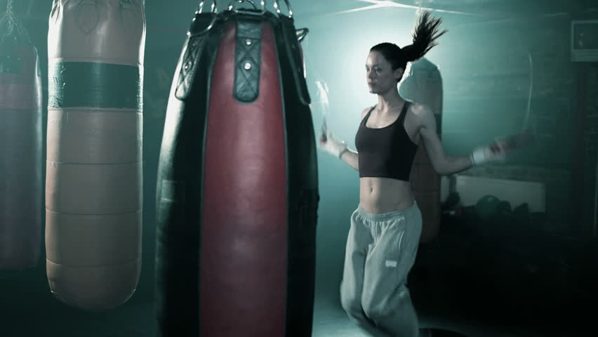 Female Boxer in Boxing Club Skipping