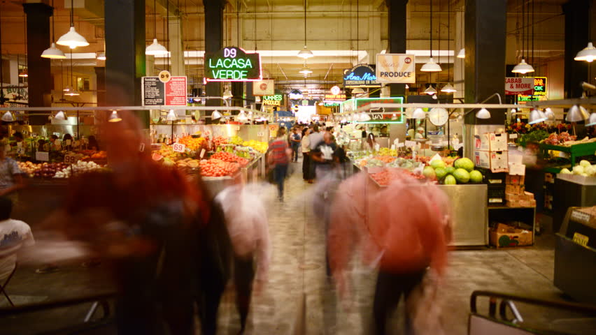 LOS ANGELES, California - April 9th: 4K Time lapse Photography with zoom in motion of unrecognizable shoppers gather at historic Grand Central Market in Downtown Los Angeles on April 9th.