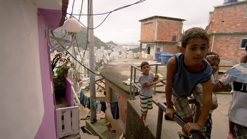 RIO DE JANEIRO, BRAZIL - JUNE 23: Slow dolly shot, favela occupants on Jun 23,