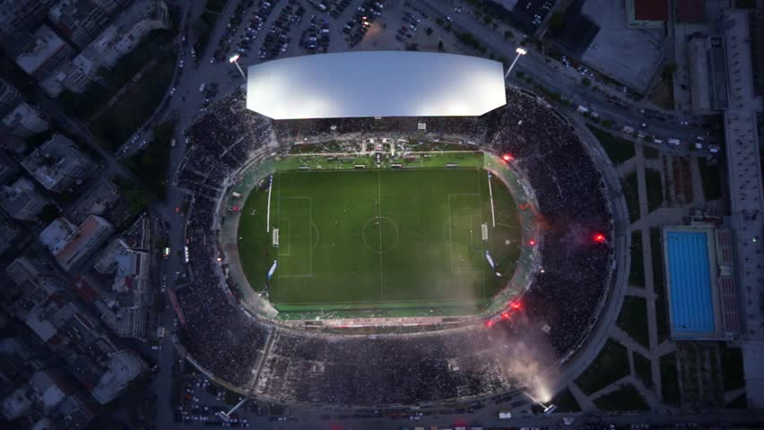 THESSALONIKI, GREECE APRIL 16, 2014 : Aerial view of the Toumba Stadium full of fans and supporters of PAOK wh? light flares during the Greek Cup Semi Final match PAOK vs Olympiacos