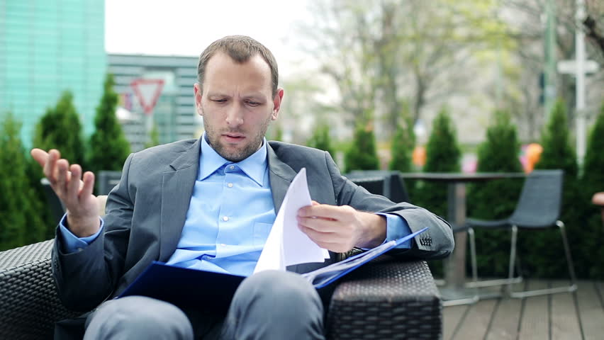 Businessman overwhelmed by to much work, bad news in documents  | Shutterstock HD Video #6159254