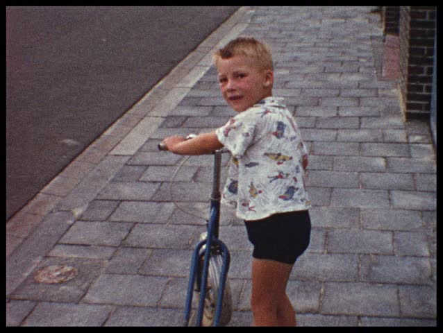 Boy with two-wheeler (vintage 8 mm amateur film)