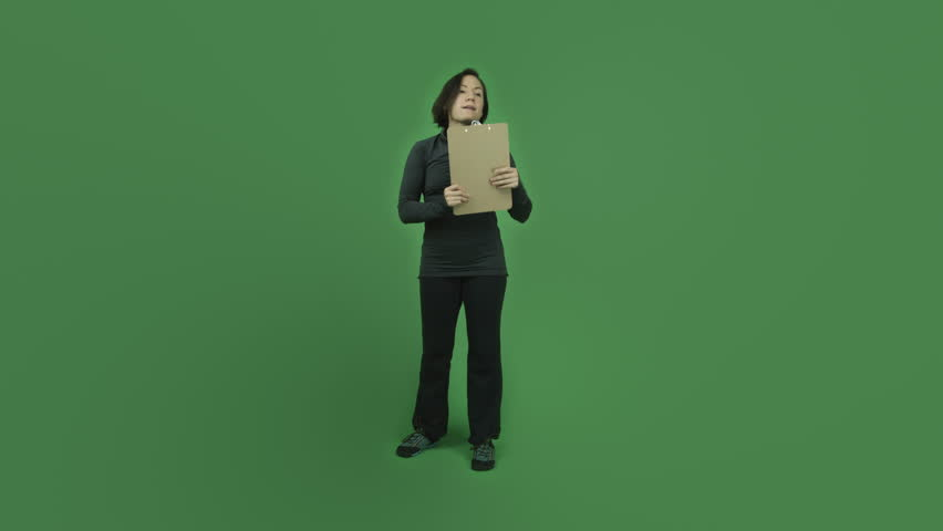 Caucasian sporty girl young adult in her 30s isolated on chroma green screen background upset with check list | Shutterstock HD Video #6186614