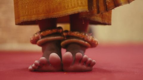 People, dancer, art and recreation, young beautiful Asian woman dancing traditional Khmer dance. Close-up of feet with gold anklets. Sequence, 16of17