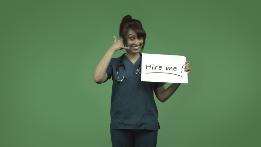 indian female doctor isolated on greenscreen with hire me sign