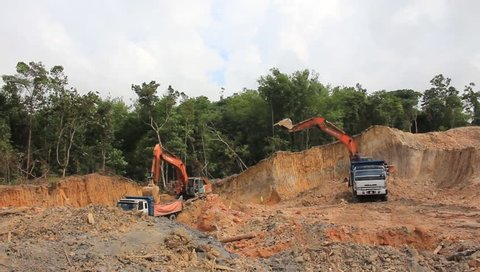 KUCHING, MALAYSIA - MAY 03 2014: Deforestation. HD Video of tropical rainforest in Borneo being destroyed to make way for oil palm plantation.