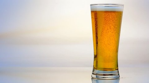Beer Glass Pour on White Background
