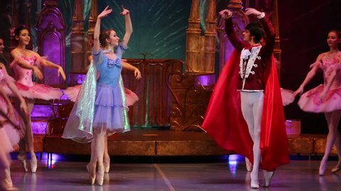 RUSSIA, MOSCOW - DEC 30, 2012: Beautiful male and female ballerina dancing ballet at New Years performance The Nutcracker and Mouse King in Cultural Center ZIL