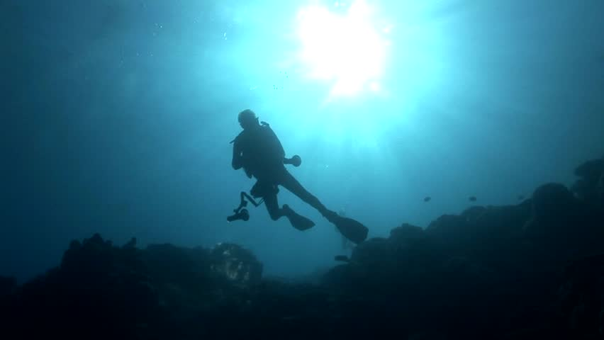 Divers in backlight in crystal clear water | Shutterstock HD Video #6271694