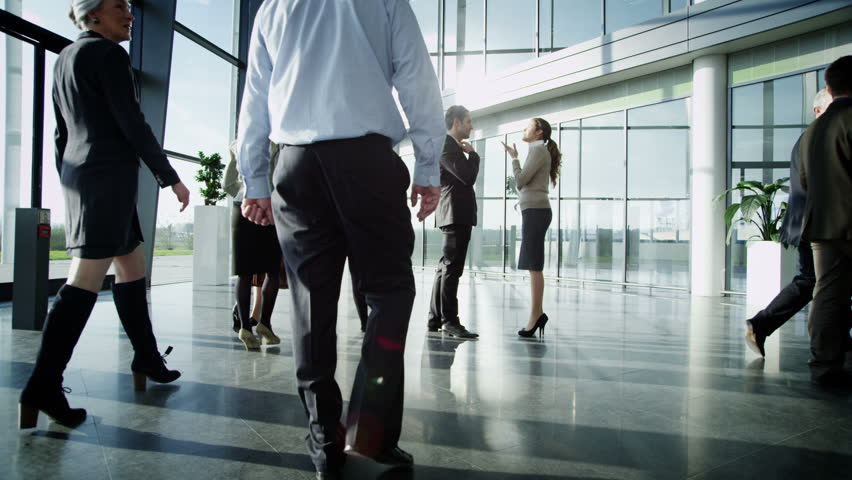 Business people having a conversation in large modern office building | Shutterstock HD Video #6285713