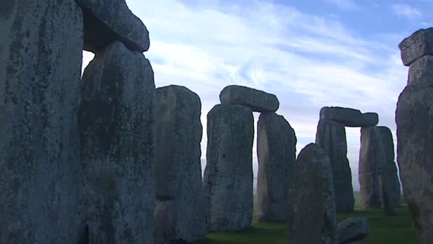 STONEHENGE, ENGLAND - Stonehenge at daybreak, a view from inside the circle - pan