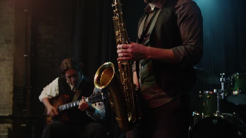 Panning shot of musician playing saxophone