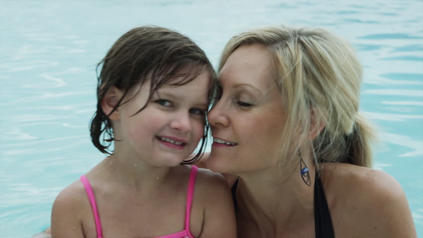 Medium Shot Portrait of mother and daughter (4-5) in pool
