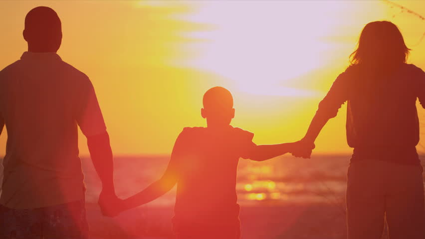 african american family celebrating beach vacation sunset ethnic parents young son standing beach sand dunes in silhouette celebrating sunset family beach