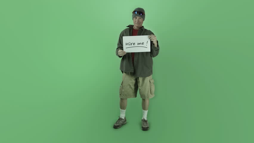 Senior caucasian outdoorsy man isolated on chroma green screen unemployed hire me sign