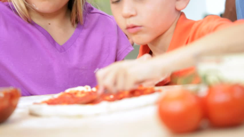 Close Up Young Blonde Caucasian Children Home Kitchen Pizza - Close up faces young blonde Caucasian brother sister helping parents prepare homemade pizza using organic produce home kitchen slow motion | Shutterstock HD Video #6341549