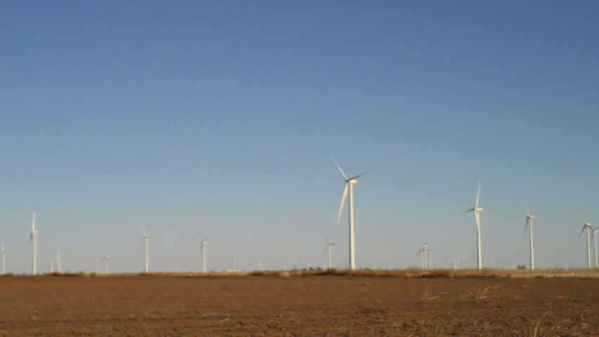 panning across fields of wind turbines