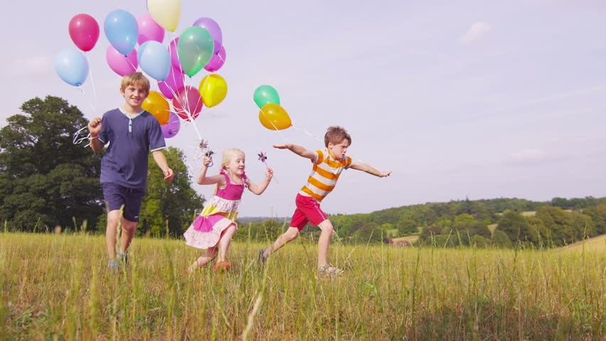 Children with Balloons Running Slow Stock Footage Video