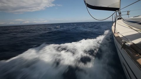 Sailing in the wind through the waves. Sailing boat shot in full HD at the Sailing in the Aegean Sea.