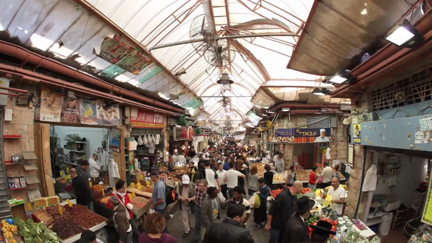 JERUSALEM, ISRAEL – DEC 31: Thousands of Israelites flock to the Mahane Yehuda market to buy fruits, vegetables, pastry, fish, meat, spices and Judaica December 31, 2009 in Jerusalem, Israel.