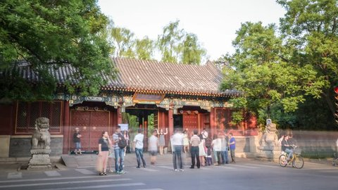Beijing,China. May,2014. Timelapse/Hyperlapse of Peking University,one of the most famous university in China. West gate with people and traffic. 4K
