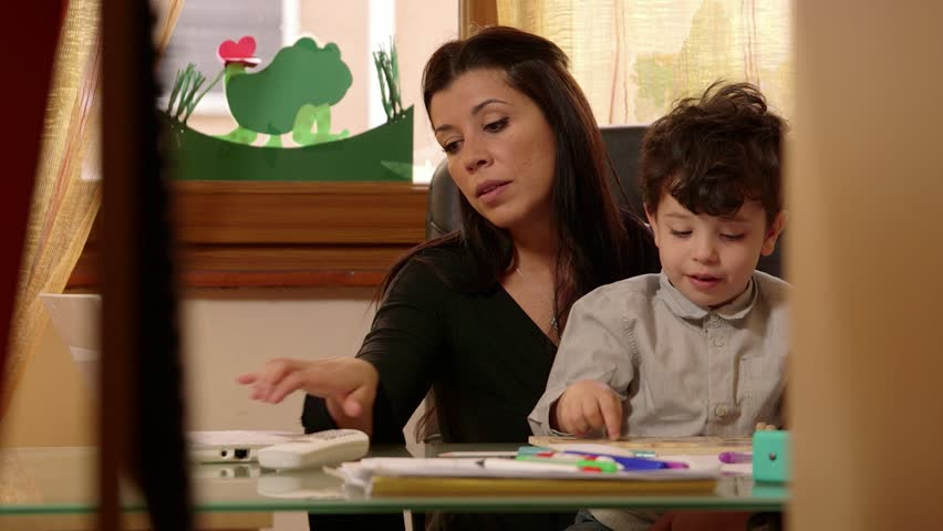 home office multitasking. delighful office multitasking mother at work with child busy son using laptop pc to home office multitasking f