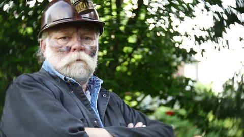 Coal miner, blue collar worker, actual suit in Kentucky.