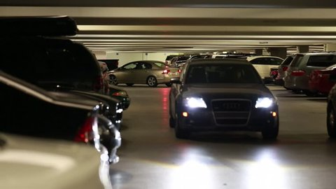 Cars driving in a busy parking garage in a city mall