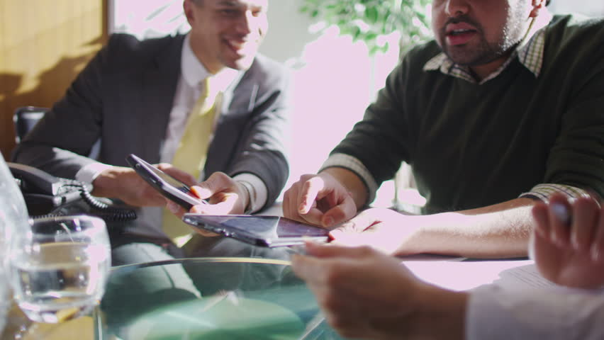Office workers discuss plans | Shutterstock HD Video #6496715