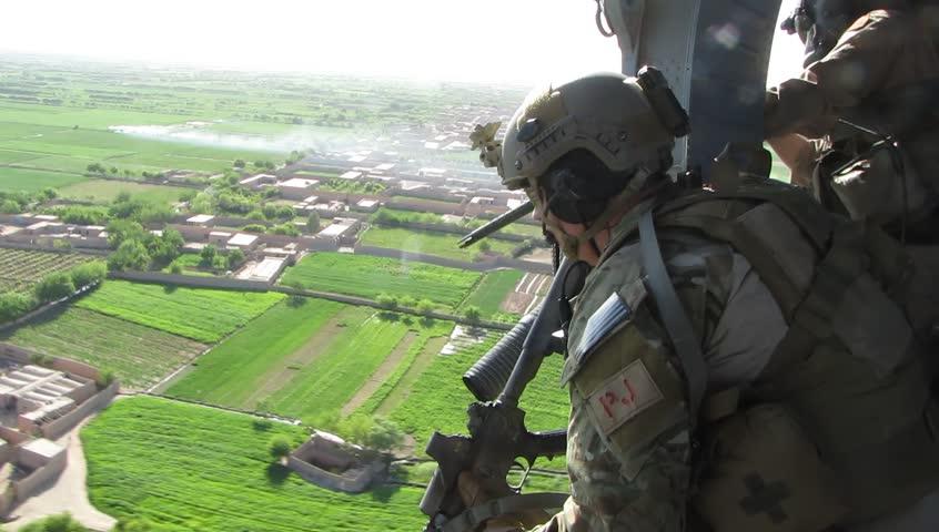 Afghanistan, Circa 2010: air force parajumper (pj) keeps eye on terrain in Afghanistan, Circa 2010