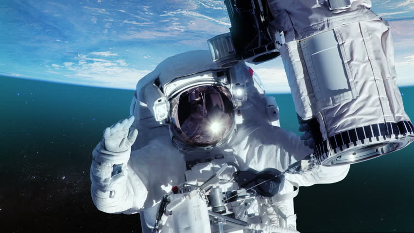 Astronaut on space. Elements of image furnished by NASA.  MORE OPTIONS IN MY PORTFOLIO.  | Shutterstock HD Video #6539954