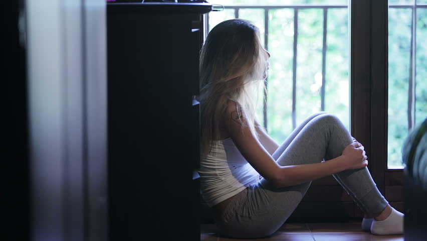 Sit In Window pensive girl is sitting near the window: loneliness, sad