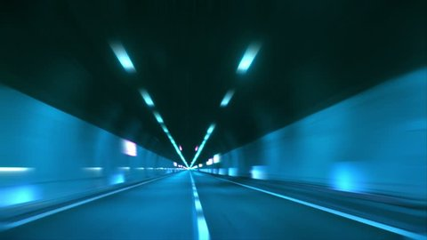 Driving through tunnel, abstract with motion blur and glow