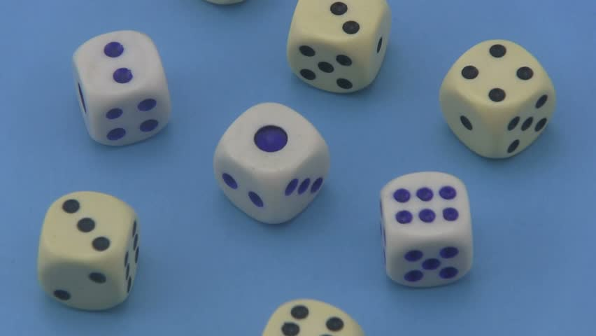 Dice that are used in board games and for gambling rotating on a blue background. | Shutterstock HD Video #6589454