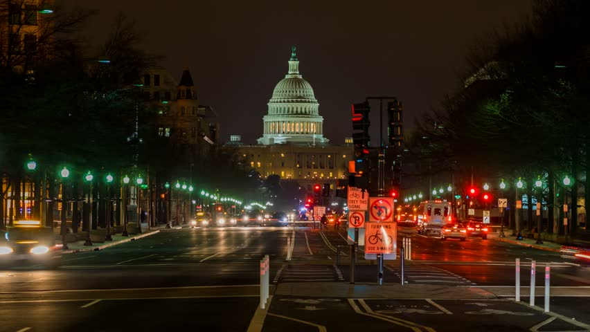 WASHINGTON DC - FEB 19: timelapse view over the Capitol Building by night which is the seat of the United States Congress on 19 February 2014 in WASHINGTON DC, USA