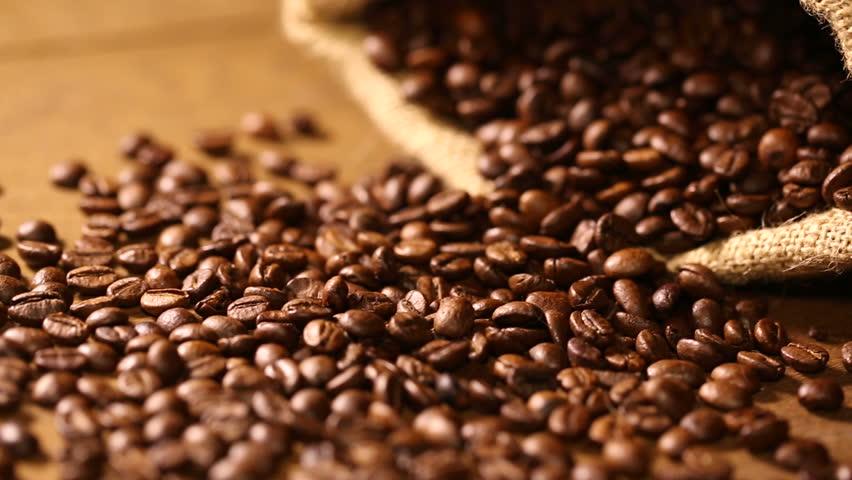 Incredible Coffee Beans On Wooden Table Stock Footage Video 100 Royalty Free 6608354 Shutterstock Inzonedesignstudio Interior Chair Design Inzonedesignstudiocom