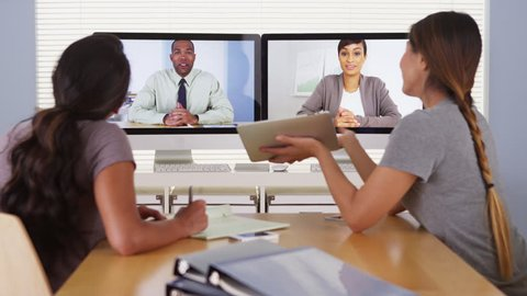 Diverse business colleagues holding a video conference meeting