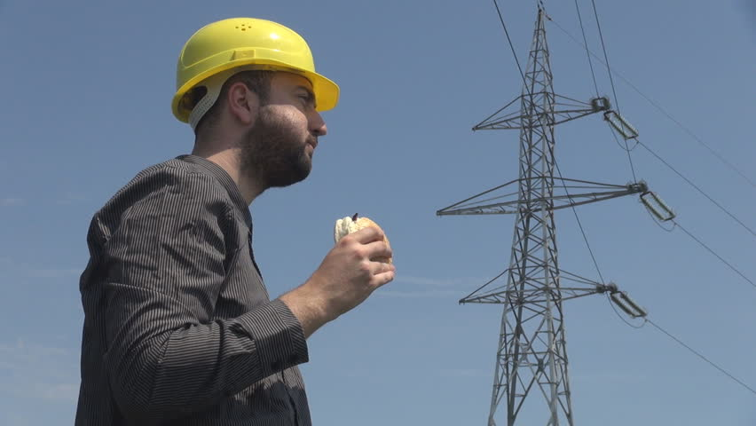 Young Electrician Eating Hamburger Swiping Sweat High Voltage Pole  Background Stock Footage Video 6647384 | Shutterstock Great Pictures