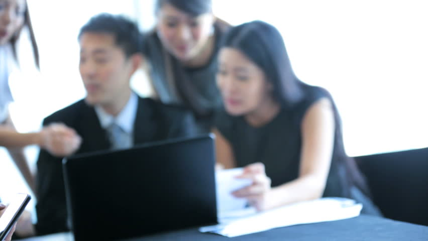 Close up young male Asian Chinese business manager foreground successful business team conference together modern city boardroom | Shutterstock HD Video #6674294