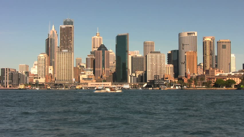 Time lapse view of boats passing through Circular Quay and Sydney Harbor with the skyline behind