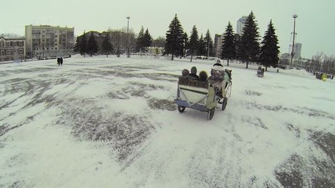RUSSIA, SAMARA - JAN 6, 2014: Horsed carriage ride by Kuibyshev Square at winter day. Aerial view