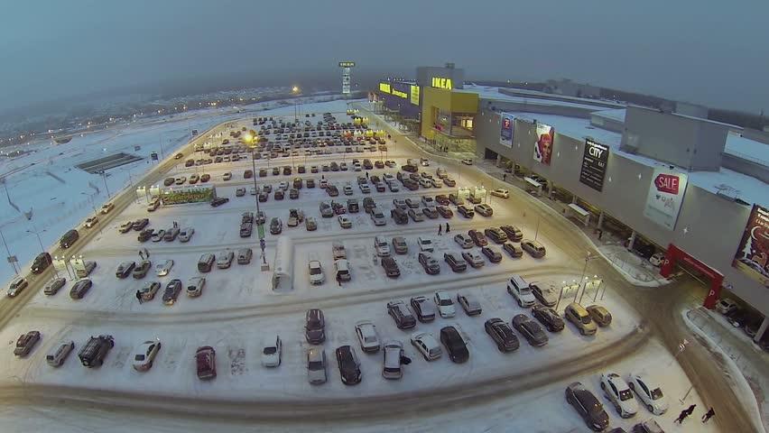 russia samara jan 5 cars ride by large parking near trade
