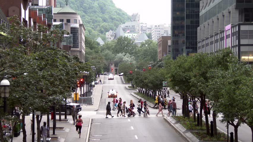 Montreal, Canada - June 2014 - 4K UHD - Pedestrians crossing boulevard with modern buildings and gothic castle in background | Shutterstock HD Video #6742840