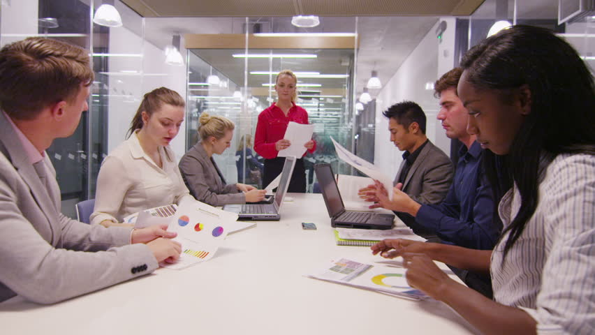 Attractive young business team in a meeting in modern city office | Shutterstock HD Video #6785254