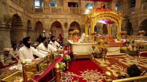 DELHI, INDIA - CIRCA MAY 2014: Gurudwara Sis Ganj, view of the Darbar Sahib or Prayer Hall. Gurudwara Sis Ganj is one of the nine historical gurdwaras or place of Sikh worship.