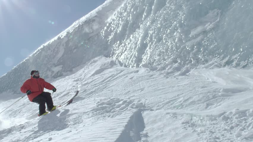 Alps, France, Alaska, 2012. A skier jumps then glides on a snow wall and lands in snow. | Shutterstock HD Video #6824614