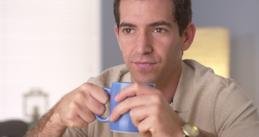 Man relaxing at home with a cup of coffee | Shutterstock HD Video #6826204