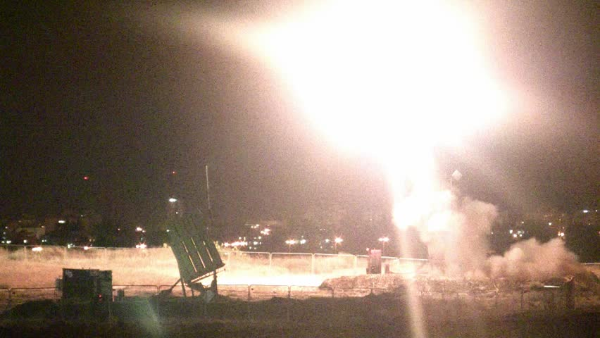 Iron Dome missile intercepts Hamas rocket during Gaza conflict operation Protective Edge, night vision shot.