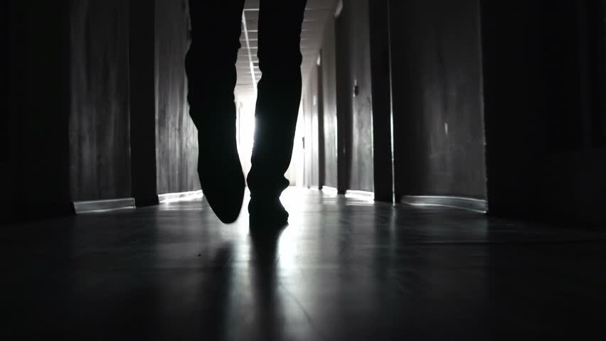 Shaky camera following footsteps of unrecognizable man going along the walkway in the dark | Shutterstock HD Video #6854404