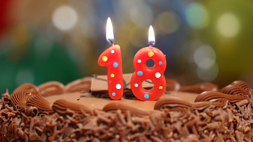 Candles On A Cake Are Blown Out For 18th Birthday